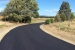 Long, sweeping asphalt driveway